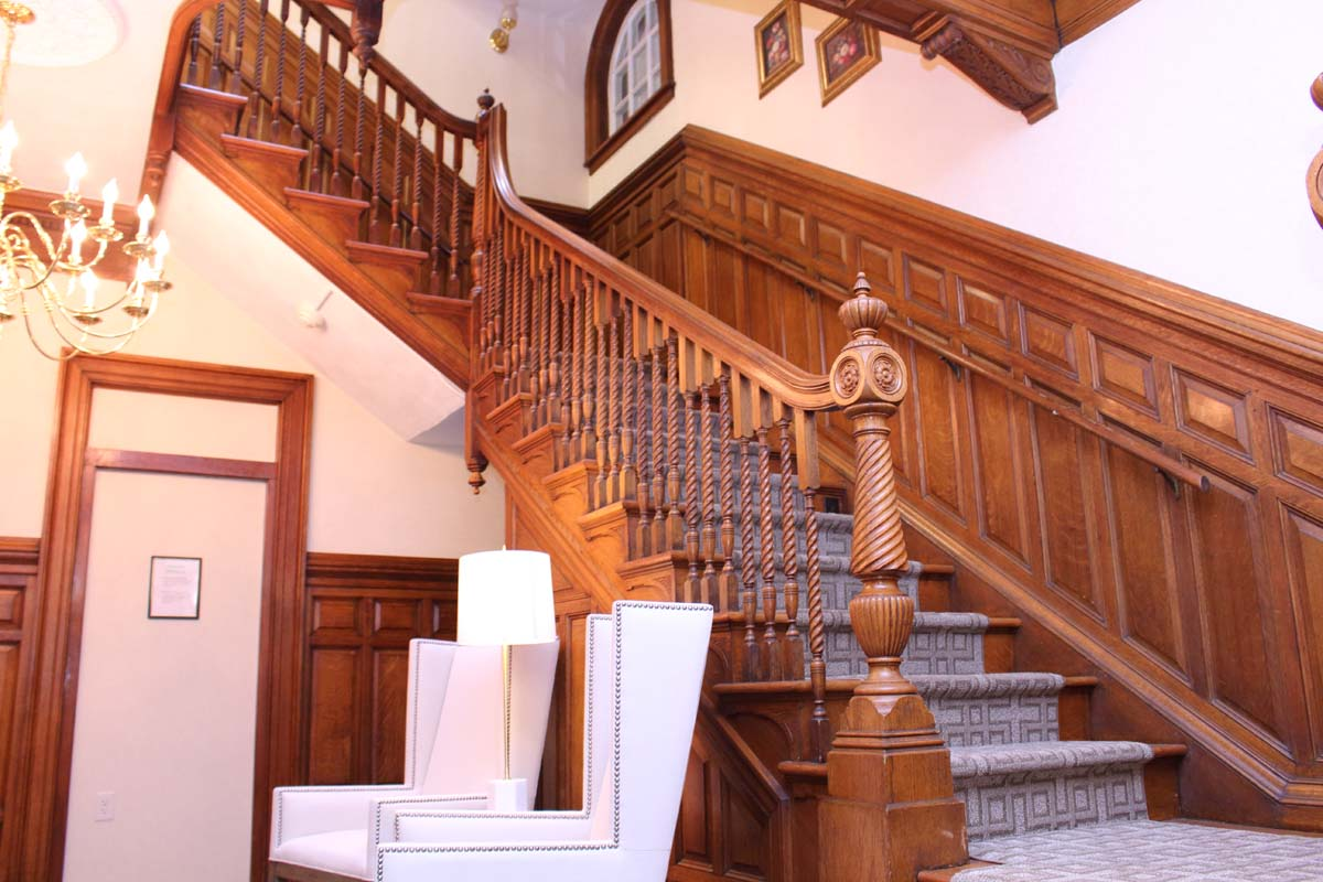 Elegantly restored original staircase in our main building.